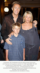 Footballer LEE CHAPMAN and his wife actress LESLIE ASH with their son at a party in London on 15th April 2003. 		PIX 348