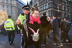 © under license to London News Pictures. 24/11/2010: Students in Manchester protest against cutbacks and the coalition government's proposed rise in tuition fees. There were some arrests after students staged a sit down protest outside Manchester Town Hall. Main roads were blocked by the numbers of protesters.