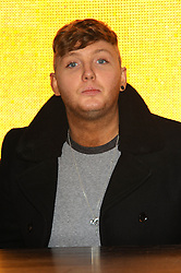 British singer and musician James Arthur who won the ninth series of The X Factor in 2012 meets fans and signs copies of his self titled album at HMV, Oxford Street, London, United Kingdom. Monday, 4th November 2013. Picture by Chris Joseph / i-Images
