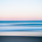 """I made visits to the beach in the late winter months to try and practice the art of incorporating motion into still seascapes.  The evening presented with pale pastels at dusk, giving my frame some pinks and purples to hold on to.  I think I've got the hang of it, and I started to even incorporate more beach into the frame.  Now I just have to find more variety and try this technique during stormy gray days, brilliant sunny days, with super long """"strokes"""" with the camera, shorter exposures with people within the frame...  The possibilities are endless!"""