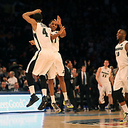 Josh Fortune, (left), Providence, celebrates hitting a three point shot with team mate Bryce Cotton during the Providence Friars Vs St. John's Red Storm basketball game during the Big East Conference Tournament at Madison Square Garden, New York, USA. 12th March 2014. Photo Tim Clayton
