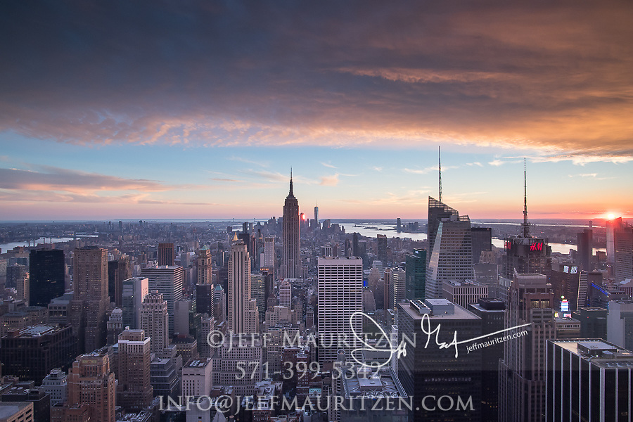 Sunset over the Empire State Building, midtown and lower Manhattan, NYC.