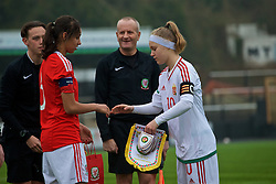MERTHYR, WALES - Tuesday, February 14, 2017: Wales' captain Amina Vine and Hungary's captain Fanni Vachter swap pennants before a Women's Under-17's International Friendly match at Penydarren Park. (Pic by Laura Malkin/Propaganda)