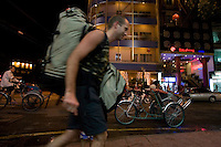 "Backpacker tourist entering backpacker street looking for accomodation. Pham Ngu Lao Street, ?Backpacker Street?, is located in Saigon, Vietnam. It was named after Pham Ngu Lao, the national hero. The Pham Ngu Lao, De Tham area refers to the tourist hub of Saigon frequented by Ho Chi Minh cities locals and tourist who flock to the market stalls, both open air and indoors to buy cheap clothes (mainly counterfeit), DVDs, souvenirs, war memorabilia. Many bars and cafes in this district are quite conveniently located near the main hotel district and Saigon's business centre. It is also called ""khu Tay ba lo"" (Backpacker's area)."