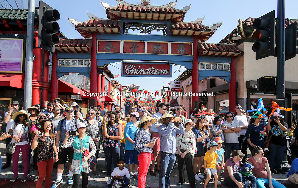Parade goers in the 117th annual Chinese New Year &quot;Golden Dragon Parade&quot; in the streets of Chinatown in Los Angeles, Saturday Feb. 13, 2016. (Photo by Ringo Chiu/PHOTOFORMULA.com)<br /> <br /> Usage Notes: This content is intended for editorial use only. For other uses, additional clearances may be required.