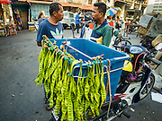 "17 NOVEMBER 2016 - GEORGE TOWN, PENANG, MALAYSIA:  A man sells ""stink beans"" (called that because they have a sharp odor when cooked) in a market in George Town, Penang, Malaysia. George Town is a UNESCO World Heritage city and wrestles with maintaining its traditional lifestyle and mass tourism.       PHOTO BY JACK KURTZ"