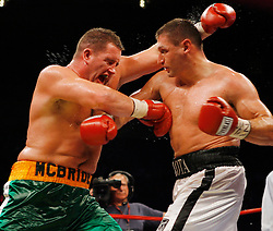 October 6, 2007; New York, NY, USA; Andrew Golota (white trunks) and Kevin McBride (Green Trunks) trade punches during their heavyweight bout at Madison Square Garden.