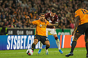 Jonny of Wolverhampton Wanderers & Daniele Baselli of Torino during the Europa League play off leg 2 of 2 match between Wolverhampton Wanderers and Torino at Molineux, Wolverhampton, England on 29 August 2019.