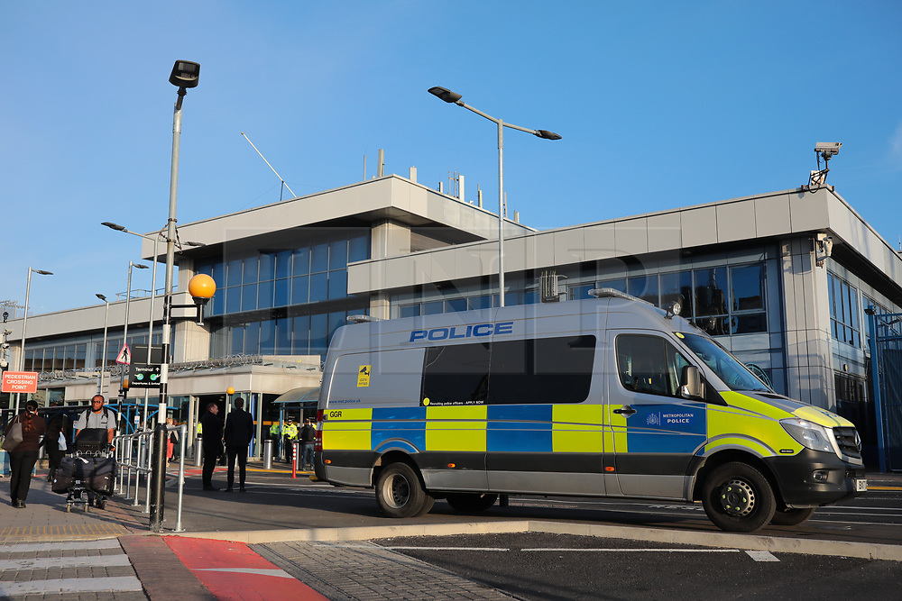 © Licensed to London News Pictures. 10/10/2019. London, UK. Police await the arrival of Extinction Rebellion protesters at London City Airport. Protesters plan to occupy the terminal building in a 'Hong Kong-style' shutdown as part of ongoing protests calling on government departments to tackle the Climate Emergency. Photo credit: Rob Pinney/LNP