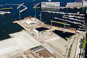 Nederland, Noord-Holland, Amsterdam, 01-08-2016; Spaandammerbuurt. Voormalige Houthavens, nu De Houthaven, gebiedsontwikkelingsproject. Diagonaal midden foto vroegere pontsteiger, het Pontsteigergebrouw in aanbouw. Silodam in de achtergrond<br /> Former timber port, industrial and harbour area. Urban development.<br /> <br /> luchtfoto (toeslag op standard tarieven);<br /> aerial photo (additional fee required);<br /> copyright foto/photo Siebe Swart