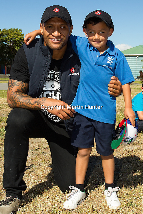 Warriors Rugby League star Manu Vatuvei during a visit to Aranui Primary School in Christchurch on Wednesday 19 December 2012. Photo: Martin Hunter/Photosport.co.nz