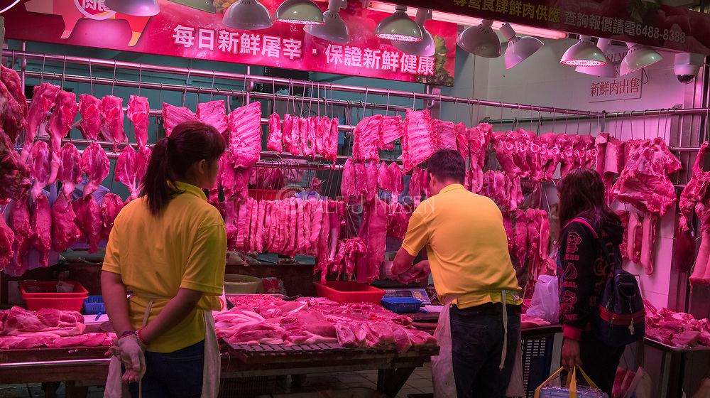 Selling red meat on Wanchai Road, Hong Kong.