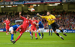 CARDIFF, WALES - Friday, September 5, 2008: Wales' Chris Gunter and Azerbaijan's goalkeeper Kamran Agayev during the opening 2010 FIFA World Cup South Africa Qualifying Group 4 match at the Millennium Stadium. (Photo by David Rawcliffe/Propaganda)