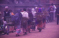 Women shopping in the early morning mist at Patan Durbar Square, Kathmandu Valley, Nepal