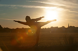 ©Licensed to London News Pictures 30/07/2020     Blackheath, UK.A young female dancer warming up for the rest of the day. Another hot weather day is expected today in the UK as a bright warm sunrise comes up over Blackheath Common this morning in London.  Photo credit: Grant Falvey/LNP