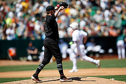 OAKLAND, CA - AUGUST 25: Mark Canha #20 of the Oakland Athletics rounds the bases after hitting a home run off of Logan Webb #62 of the San Francisco Giants during the fourth inning at the RingCentral Coliseum on August 25, 2019 in Oakland, California. The San Francisco Giants defeated the Oakland Athletics 5-4. Teams are wearing special color schemed uniforms with players choosing nicknames to display for Players' Weekend. (Photo by Jason O. Watson/Getty Images) *** Local Caption *** Mark Canha; Logan Webb