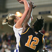Delaware Forward (#11) Elena Delle Donne drives to the hoop in the first half, Delle Donne lead all scores with 31 points as Delaware defeated Towson 75-57 Wednesday at The Bob Carpenter Center In Newark Delaware...Special to The News Journal/SAQUAN STIMPSON