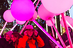 © Licensed to London News Pictures. 18/01/2020. LONDON, UK. Visitors interact with Affinity by Amigo & Amigo and S1T2  at the sixth Winter Lights festival in Canary Wharf.  25 light art and interactive installations by international artists are on display for the public to enjoy until 25 January 2020.  Photo credit: Stephen Chung/LNP