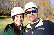 Carlee and Mike Baumgardner pose for a portrait after ziplining.