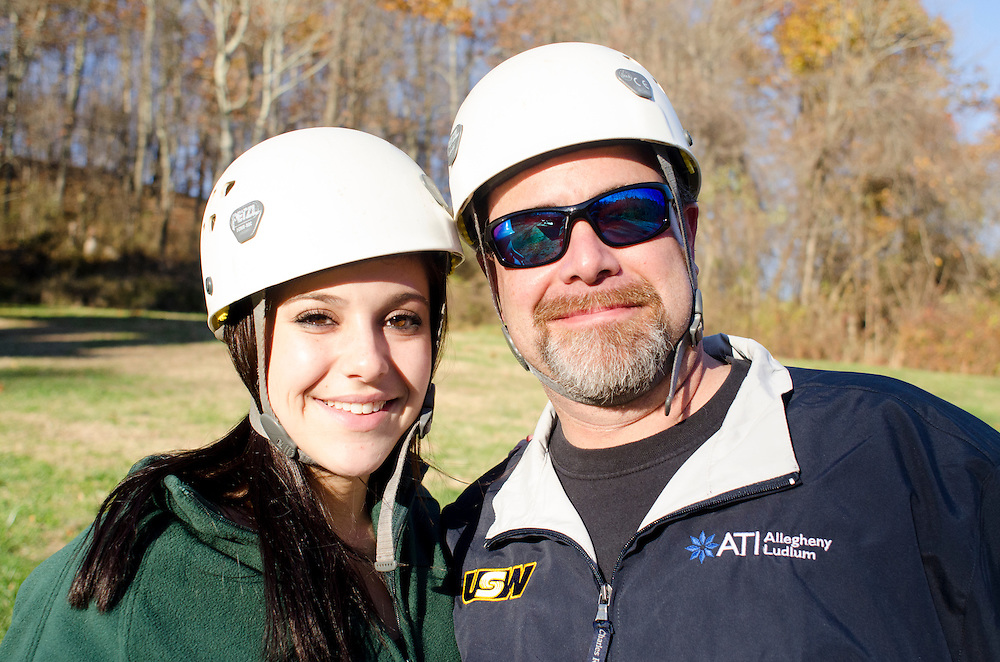 Carlee and Mike Baumgardner pose for a portrait after ziplining.