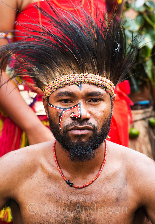 Portrait of a man from Milne Bay Province dressed in traditional tribal outfit for the Goroka Show, an annual festival in the Papua New Guinea Highlands