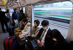 Passageiros em um vagão de metrô, no Japão. FOTO: Jefferson Bernardes/Preview.com