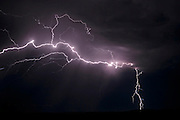 Simultaneous cloud-to-cloud and cloud-to-ground lightning bolts,  © 2015 David A. Ponton