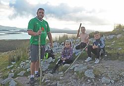 John Ward from Sligo with his 3 kids Chardonney, Shannon and Joshua on their way up Croagh Patrick on reek Sunday.<br /> Photo Conor McKeown