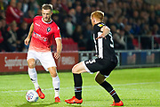 Salford City defender Scott Wiseman challenged by Grimsby Town defender Liam Gibson during the EFL Sky Bet League 2 match between Salford City and Grimsby Town FC at Moor Lane, Salford, United Kingdom on 17 September 2019.