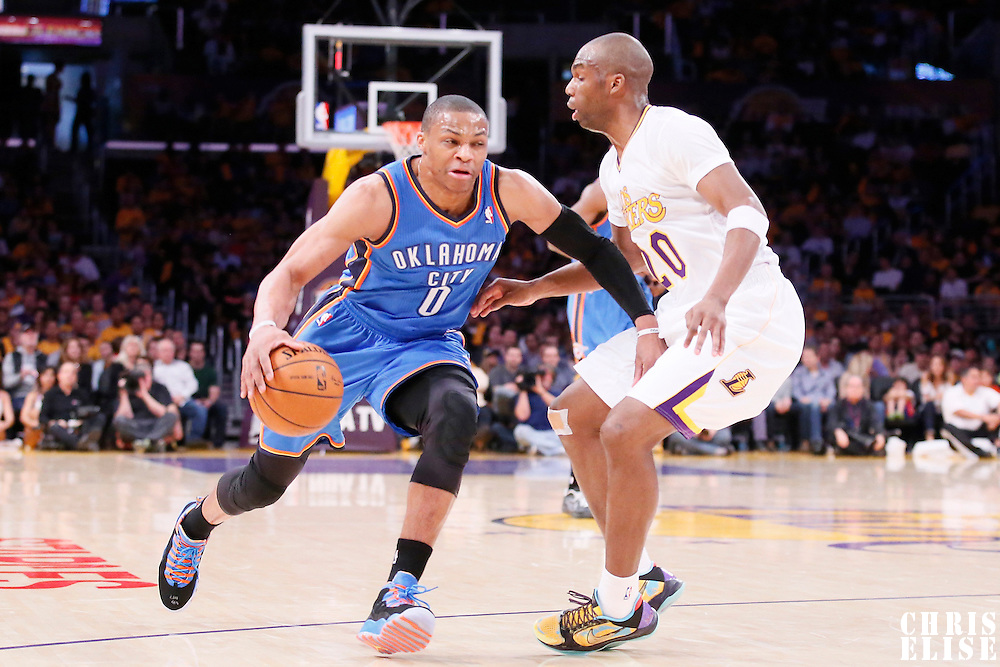 09 March 2014: Oklahoma City Thunder point guard Russell Westbrook (0) drives past Los Angeles Lakers shooting guard Jodie Meeks (20) during the Los Angeles Lakers 114-110 victory over the Oklahoma City Thunder at the Staples Center, Los Angeles, California, USA.