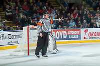 KELOWNA, CANADA - MARCH 18: Referee Ryan Benbow makes a a call  on March 18, 2015 at Prospera Place in Kelowna, British Columbia, Canada.  (Photo by Marissa Baecker/Shoot the Breeze)  *** Local Caption *** Ryan Benbow;