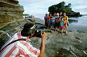 Tanah Lot. Tourists having their photo taken by a local studio photographer.