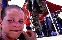 A boy next to the music stand at Ghazi Stadium, where Afghans are celebrating the closing day of SOA's games...On 23-25 August 2005, Special Olympics Afghanistan held its first national Games at Olympic Stadium in Kabul. More than 300 athletes, including 80 female athletes, experienced a taste of happiness and achievement for the first time in their lives. They competed in athletics, bocce and football (soccer). Because of cultural restrictions, males and females competed at separate venues.