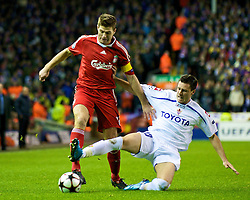 LIVERPOOL, ENGLAND - Wednesday, December 9, 2009: Liverpool's captain Steven Gerrard MBE and AFC Fiorentina's Manuel Pasqual during the UEFA Champions League Group E match at Anfield. (Photo by David Rawcliffe/Propaganda)