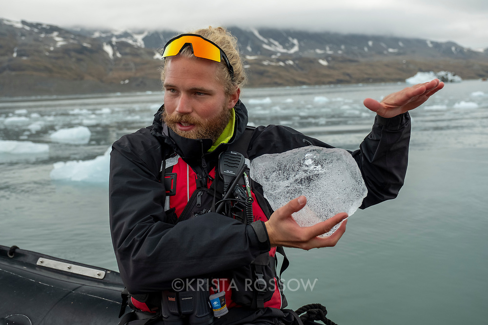 Naturalist Andreas Madsen explains the qualities of ice during an exploration of the Nordenskjold Glacier in Cumberland East Bay on the north coast of South Georgia Island.