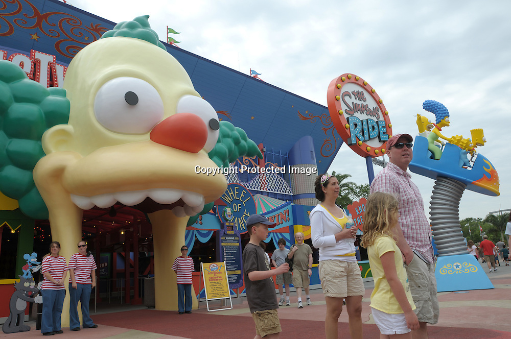 Tourists make their way past the newly-opened The Simpson's Ride at Universal Orlando in Orlando, Fla., Tuesday, April 29, 2008. (Photo by Phelan M. Ebenhack)