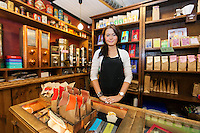 Portrait of female salesperson working in coffee shop