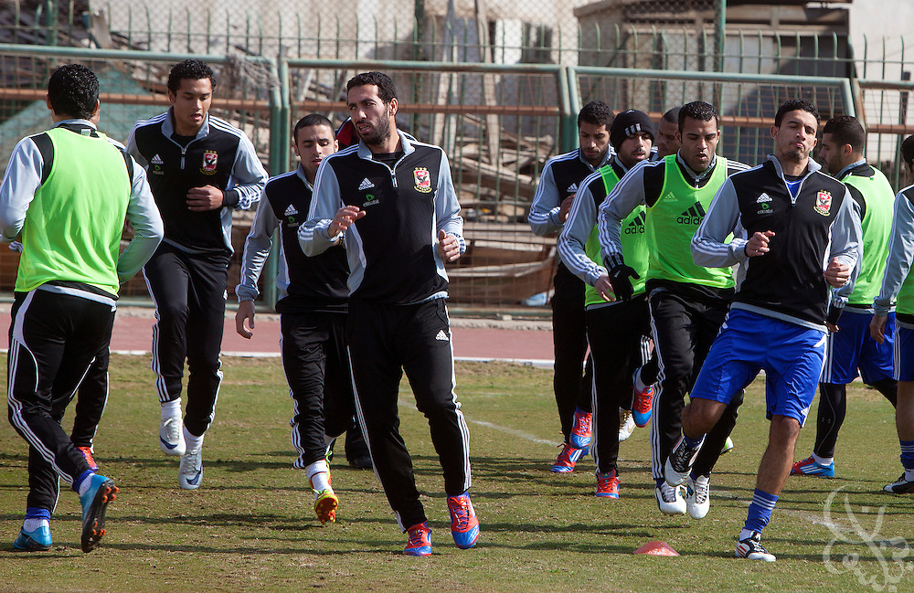 Egyptian footballer Mohamed Aboutrika (Front center/left), runs drills with teamates at the Al-Ahly club in Zamalek, Cairo Feb 20, 2012 during their first practice back since the Port Said violence that claimed the lives of at least 74 Egyptian soccer fans Feb 01, 2012.