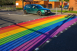 © Licensed to London News Pictures. 11/02/2020. London, UK. A car stops at a LGBT rainbow-coloured crossing outside a school in north London, which is installed in celebration of LGBT History Month. The school, which is the first one in England to have a rainbow coloured crossing outside a school, claims that it has received around 200 abusive messages on social media. Photo credit: Dinendra Haria/LNP