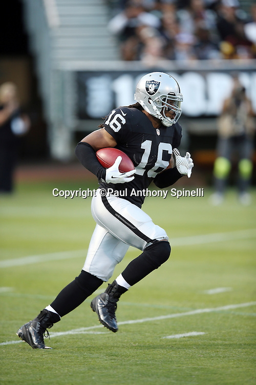 Oakland Raiders wide receiver Josh Cribbs (16) returns a first quarter kickoff during the NFL preseason week 3 football game against the Chicago Bears on Friday, Aug. 23, 2013 in Oakland, Calif. The Bears won the game 34-26. ©Paul Anthony Spinelli