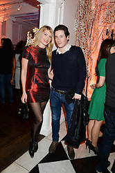 MEREDITH OSTROM and BLAISE PATRICK at the launch of Gordon's 'Ten Green Bottles' by Temperley London held at Temperley London Flagship, 27 Bruton Street, London on 6th November 2013.