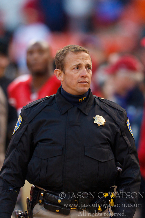 Nov 20, 2011; San Francisco, CA, USA; A California highway patrolman on the San Francisco 49ers sidelines during the fourth quarter against the Arizona Cardinals at Candlestick Park. San Francisco defeated Arizona 23-7. Mandatory Credit: Jason O. Watson-US PRESSWIRE