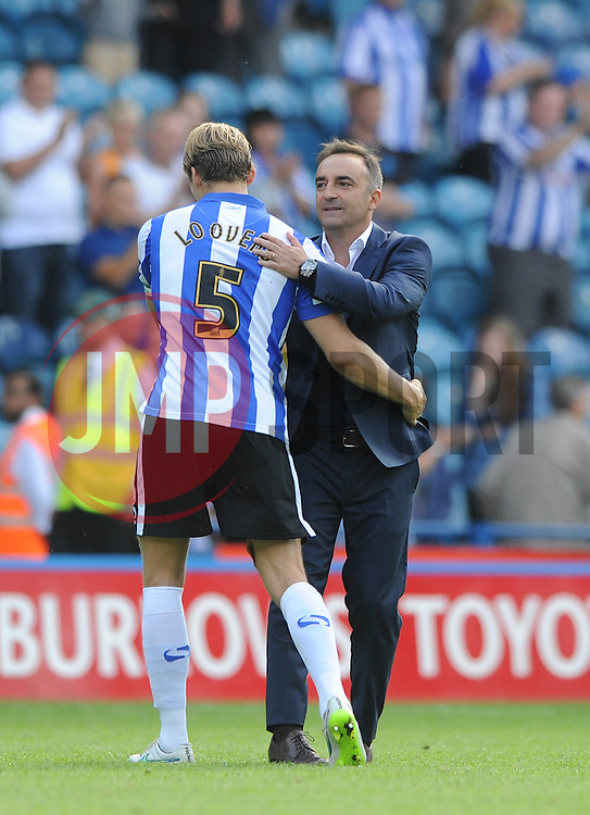 Glenn Loovens of Sheffield Wednesday is congratulated by Sheffield Wednesday Manager Carlos Carvalhal at the end of the game - Mandatory byline: Dougie Allward/JMP - 07966386802 - 08/08/2015 - FOOTBALL - Hillsborough Stadium -Sheffield,England - Sheffield Wednesday v Bristol City - Sky Bet Championship