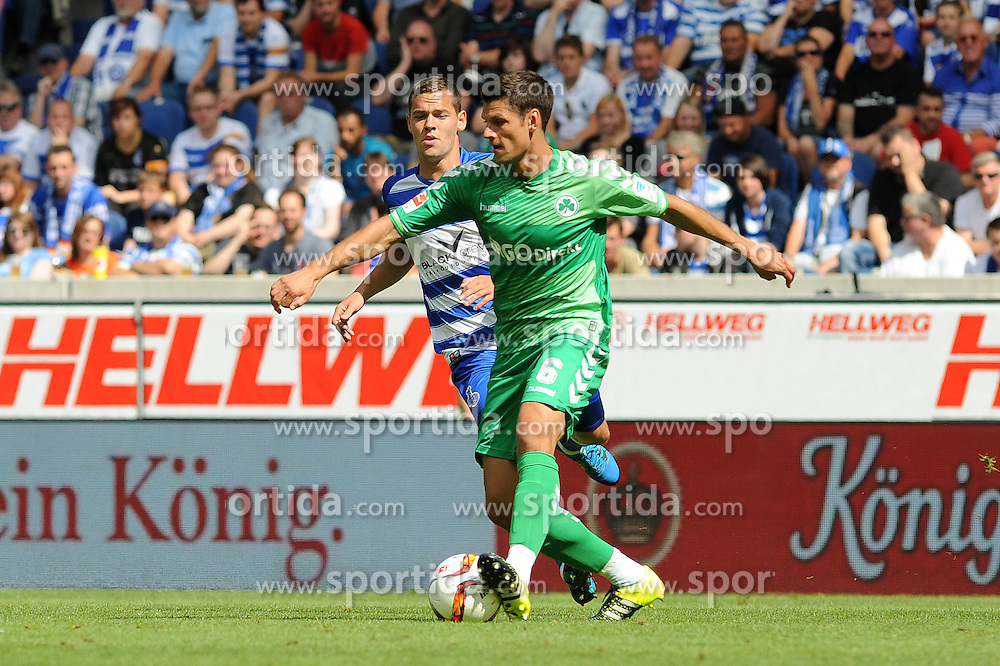29.08.2015, Duisburg, GER, 2. FBL, MSV Duisburg vs SpVgg Greuther Fuerth, 5. Runde, im Bild Stanislav Iljutcenko ( links MSV Duisburg ) im Zweikampf mit Andreas Hofmann ( rechts SpVgg Greuther Fuerth ) // during the 2nd German Bundesliga 5th round match between MSV Duisburg and SpVgg Greuther Fuerth at the Schauinsland Reisen Arena in Duisburg, Germany on 2015/08/29. EXPA Pictures &copy; 2015, PhotoCredit: EXPA/ Eibner-Pressefoto/ Thienel<br /> <br /> *****ATTENTION - OUT of GER*****
