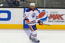 Mar 6, 2012; San Jose, CA, USA; Edmonton Oilers defenseman Theo Peckham (24) warms up before the game against the San Jose Sharks at HP Pavilion. Edmonton defeated San Jose 3-2 in shootouts. Mandatory Credit: Jason O. Watson-US PRESSWIRE