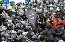 Sept. 7, 2017 - Seongju, South Korea - Protesters clash with the police during a demonstration against the Terminal High Altitude Area Defense (THAAD) in Seongju, South Korea. Seoul's defense ministry said the remaining THAAD elements and other construction equipment would be delivered to the former golf course at Soseong-ri village in Seongju county, North Gyeongsang province within Thursday, and thousands of policemen violently dispersed peace activists and residents living near the site of the THAAD missile defense system.  zcc) (Credit Image: © Yao Qilin/Xinhua via ZUMA Wire)