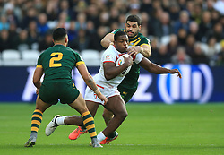 England's Jermaine McGillvary is tackled by Australia's Greg Inglis (right) and Valentine Holmes (left) during the Four Nations match at London Stadium.