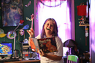 PT_339373_FITT_pasfaith_1.BRENDAN FITTERER   |   Times.(06/02/2011 New Port Richey) With her glitter-filled wand in hand, Kyrja (cq, first name only) shows off her children's book, Rupert's Tales, in her colorful New Port Richey home office where she writes. .BRENDAN FITTERER   |   Times