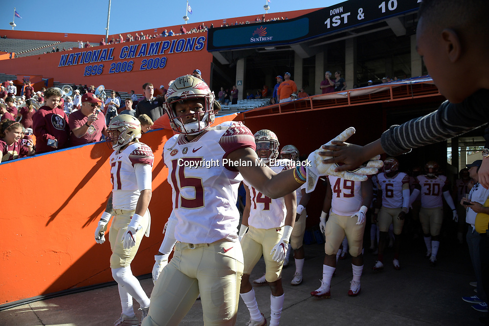 Florida State defensive back Carlos Becker III (15) walks onto the field before an NCAA college football game against Florida Saturday, Nov. 25, 2017, in Gainesville, Fla. (Photo by Phelan M. Ebenhack)