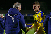 AFC Wimbledon midfielder Jack Rudoni (12) shakes the hand of AFC Wimbledon Manager Glyn Hughes after the EFL Trophy match between Southend United and AFC Wimbledon at Roots Hall, Southend, England on 13 November 2019.